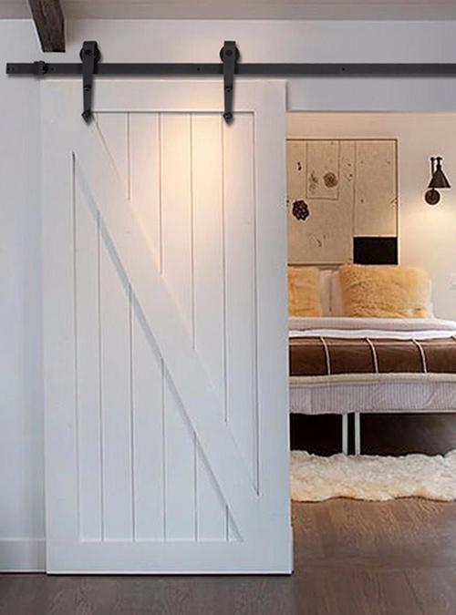 Porta interni scorrevole o porta fienile bianca in legno massello