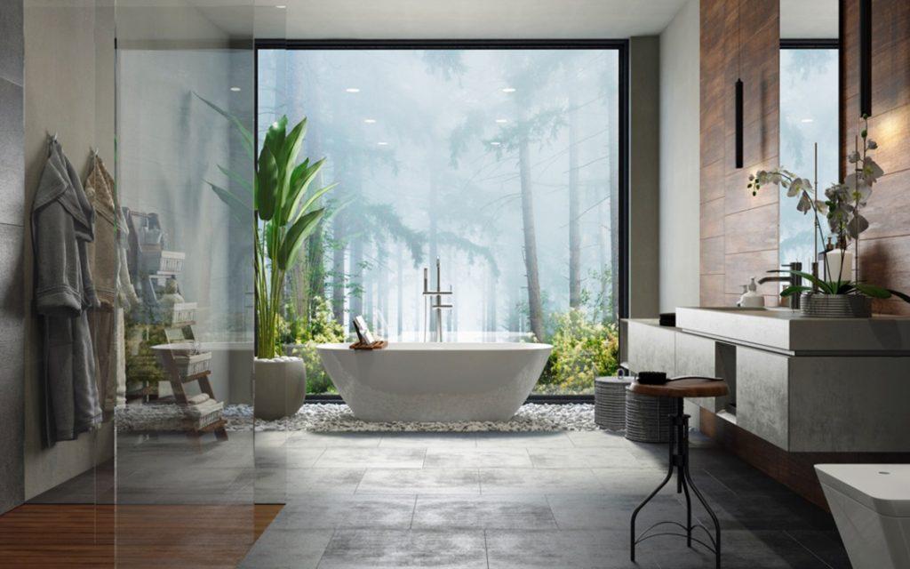 Un bagno patronale con mobile bagno sospeso, vasca e box doccia in vetro